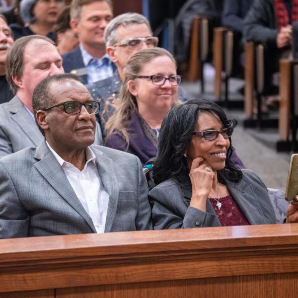 Debesai and Azeib Neguse proudly listen to their son U.S. Representative Joe Neguse, following a swearing-in event. Photo by Glenn Asakawa.