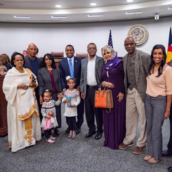 Family gather for a portrait following a ceremonial swearing-in event for U.S. Representative Joe Neguse. Photo by Glenn Asakawa.