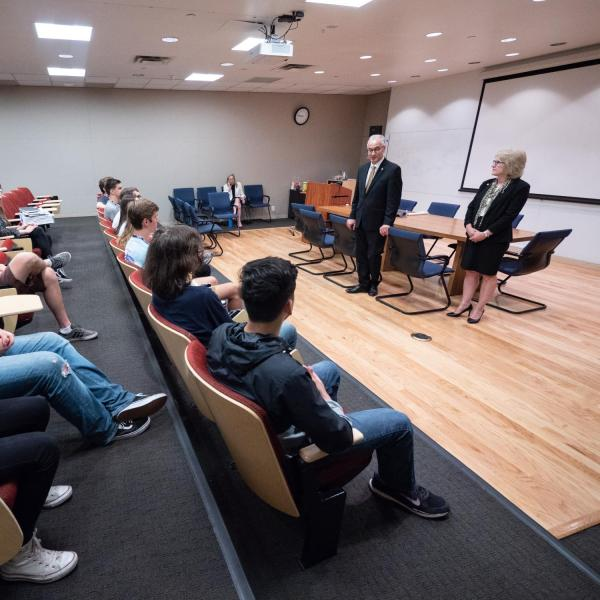 CU President Mark Kennedy, standing at left, and his wife Debbie, listen to undergraduate student staff answer questions during a tour of CU Boulder's Laboratory for Atmospheric and Space Physics (LASP) on July 1, 2019, Kennedy's first official day on the job.