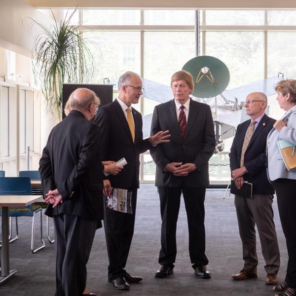 CU President Mark Kennedy, second from left, chats with Dan Baker, center, director of the Atmospheric and Space Physics (LASP), Provost Russ Moore and Terri Fiez, Vice Chancellor for Research & Innovation during a tour of the facility on July 1, 2019, Kennedy's first official day on the job. Chancellor Phil DiStefano is at far left.