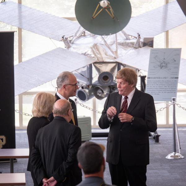 CU President Mark Kennedy, in glasses, chats with Dan Baker, center, director of the Atmospheric and Space Physics (LASP), during a tour of the facility on July 1, 2019, Kennedy's first official day on the job. Kennedy's wife, Debbie and Chancellor Phil DiStefano is visible in the foreground.