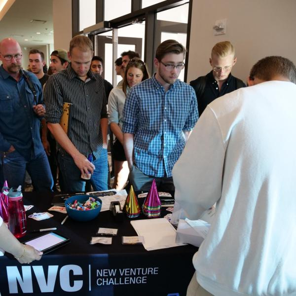 New Venture Challenge attendees line up at registration table