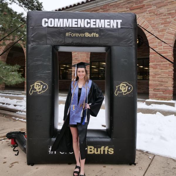 Allie Shea Reuter poses at the 2021 Graduation Appreciation Days photo posing station outside the UMC at CU Boulder. (Photo by Casey A. Cass/University of Colorado)