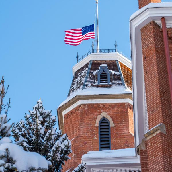 Snowy campus and a half-mast flag on Monday. Photo by Patrick Campbell.
