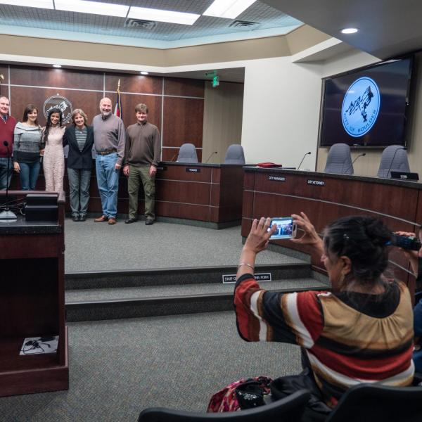 Serene Singh, third from left, gets her photo taken by her mother, Nitu and sister Naureen (in foreground) with Boulder Mayor Suzanne Jones Boulder City Council members. (Glenn Asakawa/University of Colorado)
