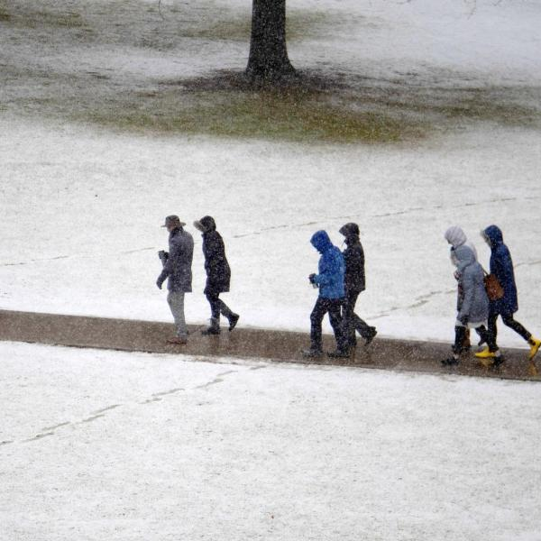 People walk across a snowy campus. Photo by Casey A. Cass.