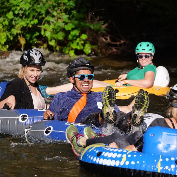 Tubers ride the Boulder Creek during Tube to Work Day 2017