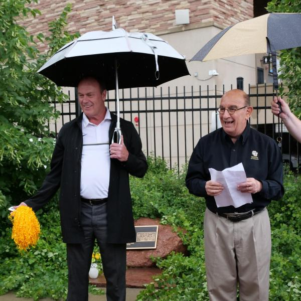 Chancellor Philip DiStefano, right, Athletic Director Rick George and others gathered on June 26 for a tree dedication ceremony honoring CU Buffs super fans Peggy Coppom and her late sister, Betty Hoover. (Photo by Glenn Asakawa/University of Colorado)