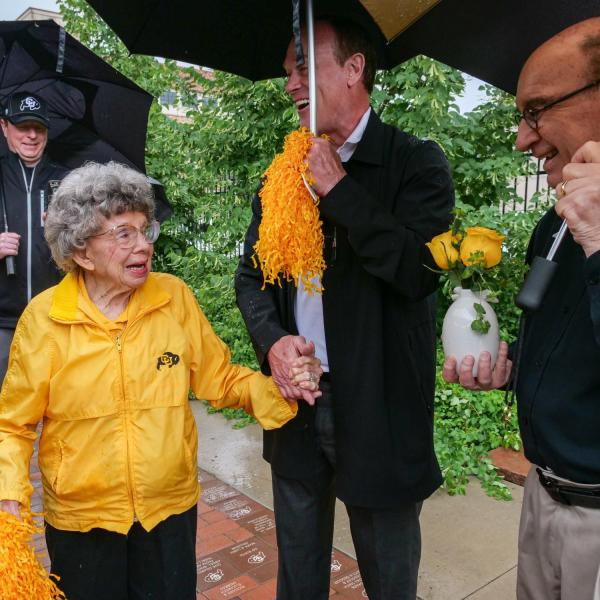 """Chancellor Philip DiStefano, Athletic Director Rick George and others gathered on June 26 for a tree dedication ceremony honoring a pair of CU Buffs super fans known simply as """"The Twins"""" -- Peggy Coppom and her late sister Betty Hoover. (Photo by Glenn Asakawa/University of Colorado)"""