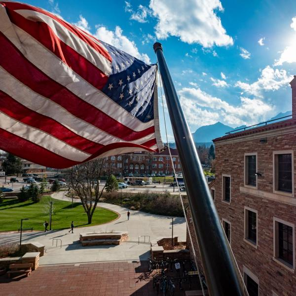 American flag flies in front of the University Memorial Center, marking Veterans Day 2018. Photo by Glenn Asakawa.