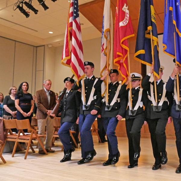 The Joint ROTC Color Guard presents during the Veterans Day Ceremony in the University Memorial Center. Photo by Casey A. Cass.