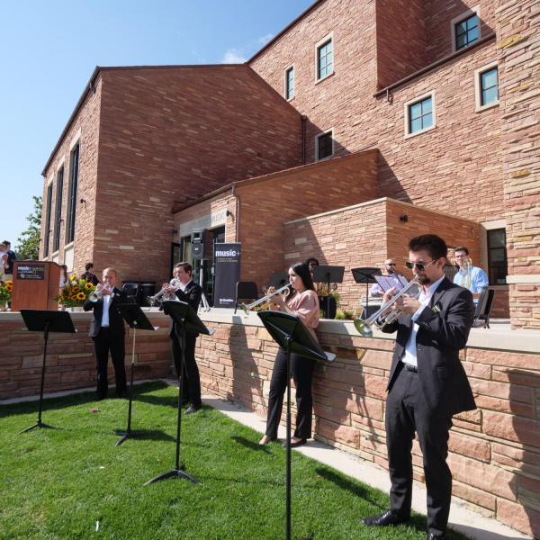 Musicians open up ceremonies as attendees gather for the official ribbon-cutting and opening of the Warner Imig Music building expansion on Sept. 17, 2021. (Photo by Glenn Asakawa/University of Colorado)
