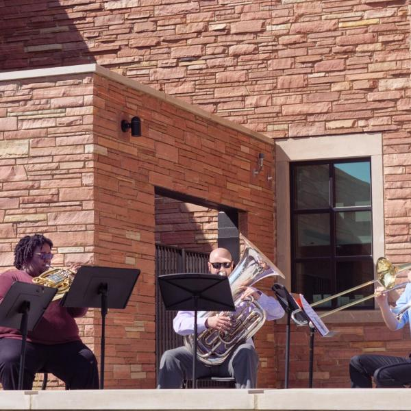A brass ensemble performs during the official ribbon-cutting and opening ceremony of the Warner Imig Music building expansion on the CU Boulder campus on Sept. 17, 2021. (Photo by Glenn Asakawa/University of Colorado)
