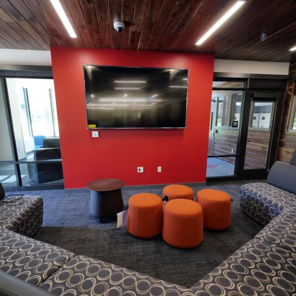 A large flatscreen TV will be hooked up to an eight-player gaming system in the main lobby and gathering space at the new Williams Village East residence hall on the CU Boulder campus. (Photo by Glenn Asakawa/University of Colorado)