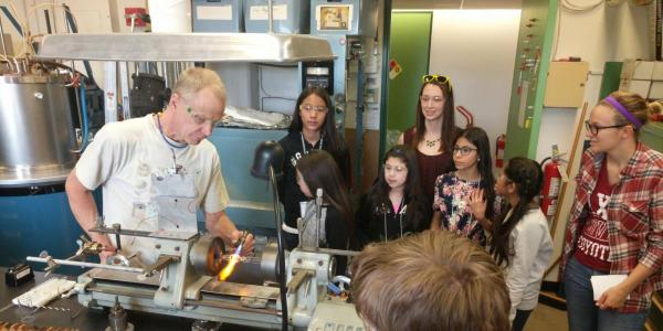 Young students learning in a CU Boulder workshop