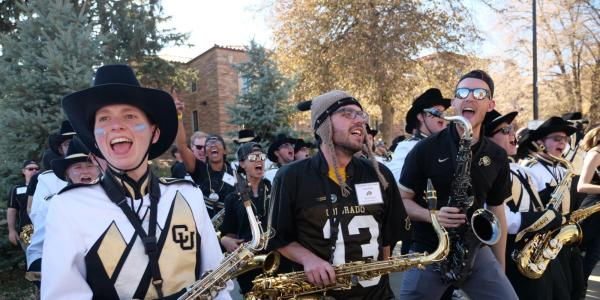 Members and alumni of the CU Marching Band perform during pre-game festivities for Homecoming weekend on the CU Boulder campus on Saturday, Nov. 9, 2019. (Photo by Glenn Asakawa/University of Colorado)