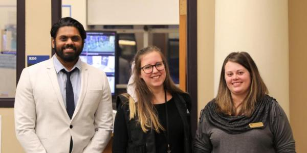Students working with University Libraries' security force