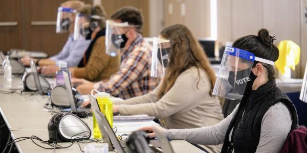Poll workers. (Photo by Glenn Asakawa/University of Colorado)