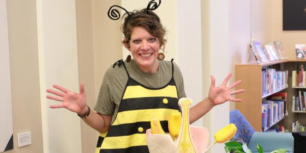An instructor dressed in a bee costume