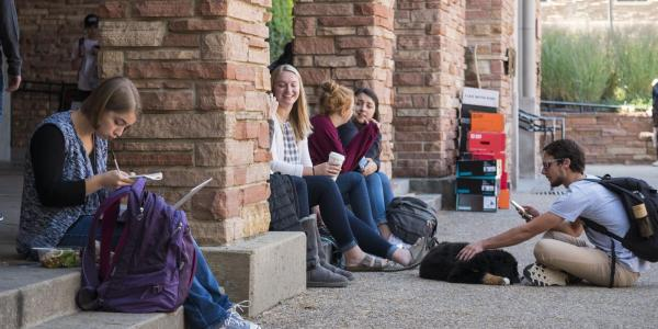 Campus community members sit outside the University Memorial Center