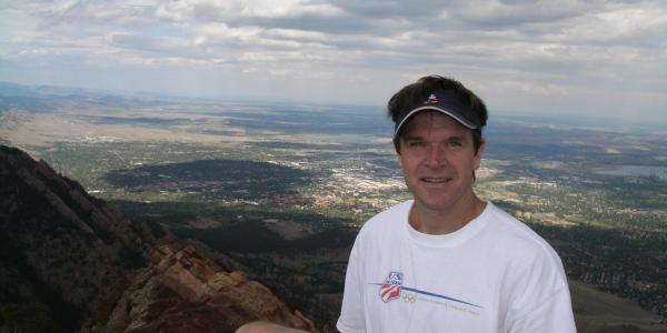 Glen Abramowski, with Boulder and CU campus in the background
