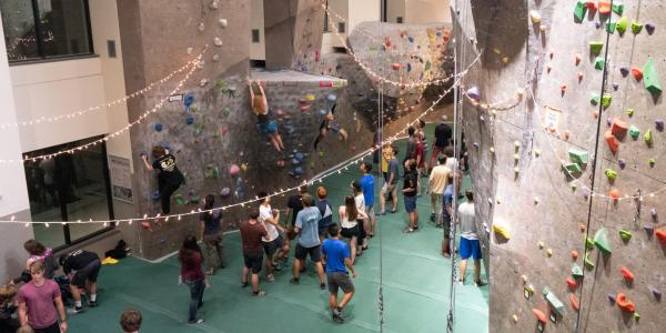 Students hang out by the climbing gym during Connect at The Rec event