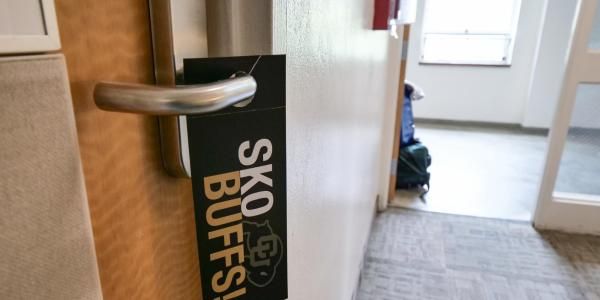 Cool door hangers in Libby Hall. Volunteers, students and parents work together to move students back onto the CU Boulder campus on Sunday, August 19, 2018. (Photo by Glenn Asakawa/University of Colorado)