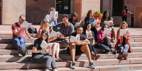 People reading on the steps of Norlin Library