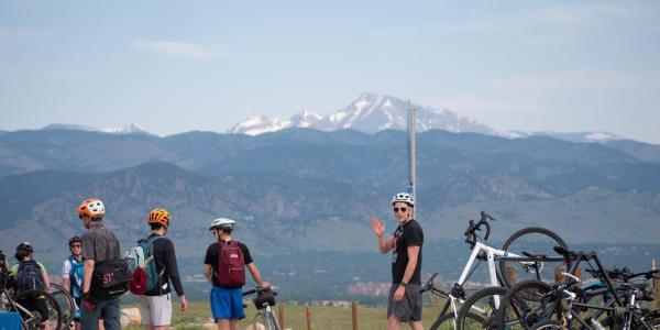 Bicyclists with mountains in the background