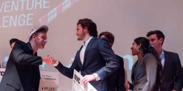 Stride Tech founders on stage at Boulder theater after winning the New Venture Challenge. (2019 file image)
