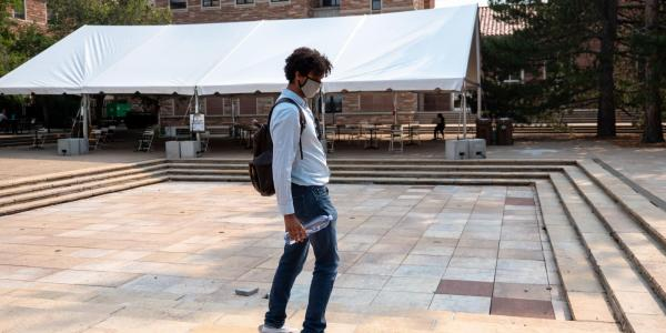 Student skateboarding on campus