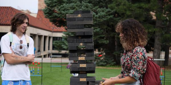 Students playing lawn Jenga at a CU event