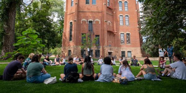 Students enjoying class outside on the first day of classes.
