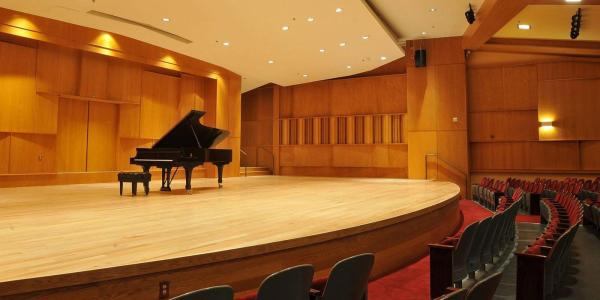 A piano onstage at Grusin Music Hall