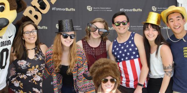 Graduating Buffs pose for photobooth photo at Grad Bash 2017