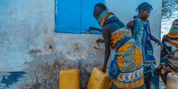 People gathering water in urban Africa