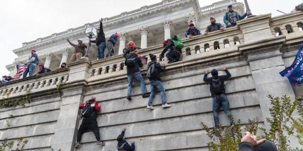 People scaling the outside walls of the U.S. Capitol during the Jan. 6 protests and insurrection in Washington, D.C.