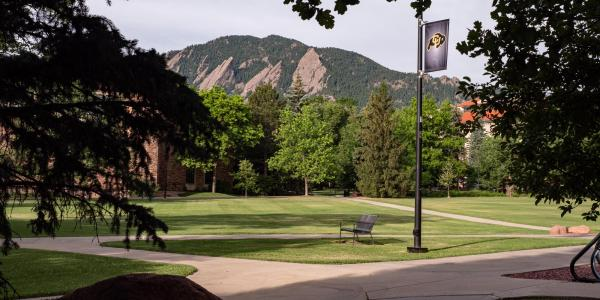 A view of the Flatirons from a quiet CU Boulder campus.