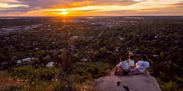 CU Boulder students watch sunset from Flagstaff Mountain