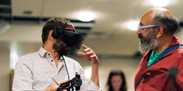 A person using a virtual reality headset and controllers