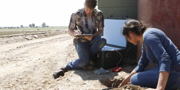 Graduate students install and monitor a seismometer