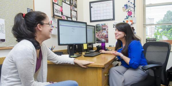 Student talks with academic advisor