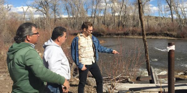 3 men standing on the edge of a river in the San Luis Valley