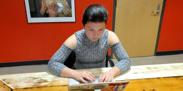 Student Alana Faller works on laptop computer