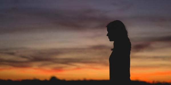 silhouette of person at sunset