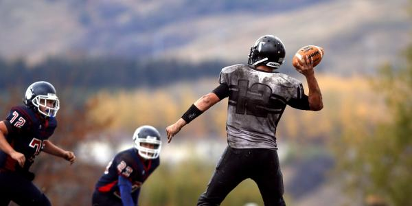 teens playing football