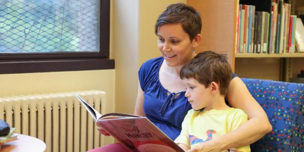 A parent reading to a child