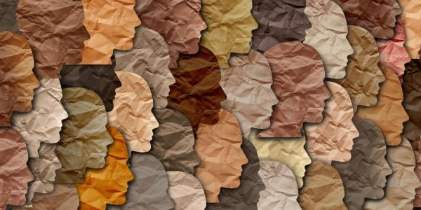 A collage of different colored paper faces