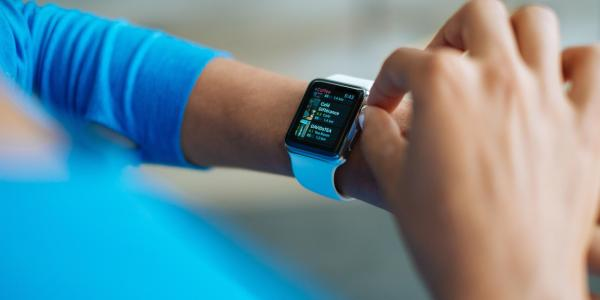 Person checks Apple Watch