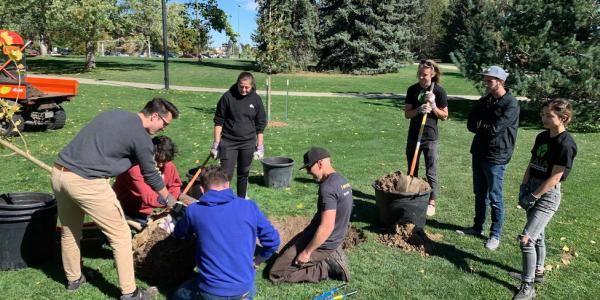 CU community members planting trees in observance of Arbor Day